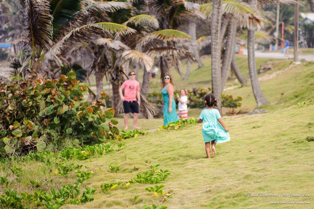 Girl running on grass at Bathsheba.