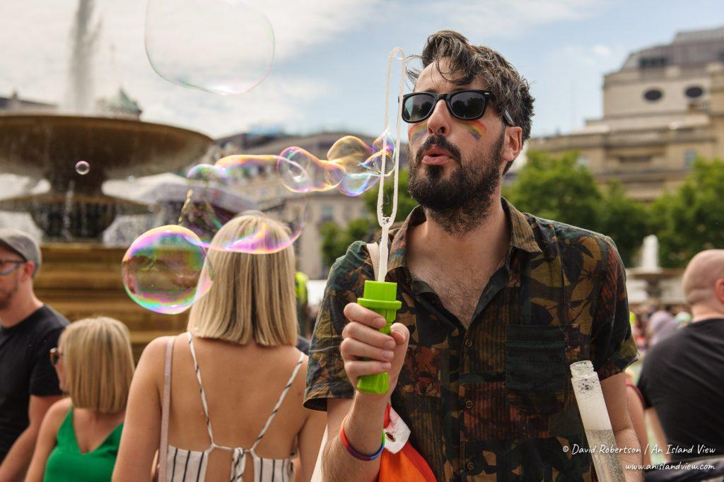 Man blowing bubbles.